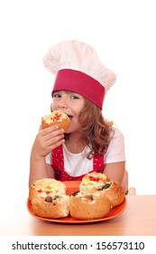 little girl cook eat bread filled with cheese and vegetables