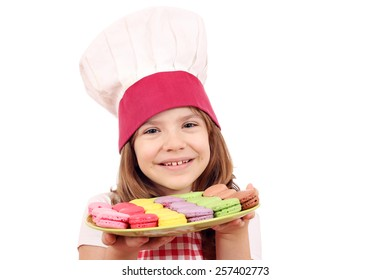 little girl cook hold plate with macarons