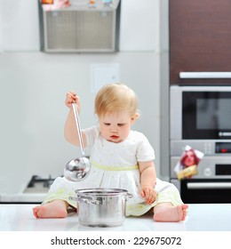 Little girl cooking on a kitchen