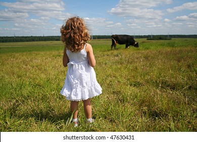 Little girl and cow