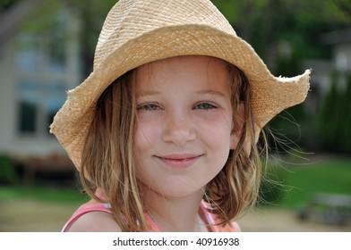little girl in cowboy hat