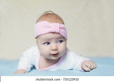 little girl crawling on the bedspread