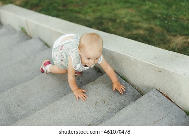 little girl crawling on stairs