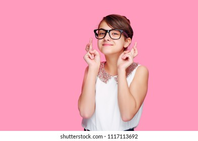 Little girl crosses fingers to fulfill her dreams