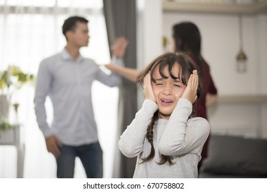 Little girl was crying because dad and mom quarrel, Sad and dramatic scene, Family issued, Children's Rights abused in Early Childhood Education and Social and parents care problem concept