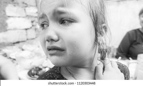 Little girl crying. B/W photo
