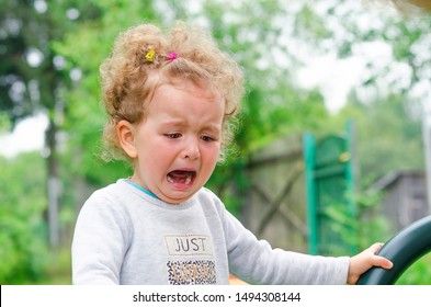 little girl crying. offend the child. children's tears and moods. comfort and feel sorry for the baby. hopelessness, despair, sobbing, resentment. tears on eyes. fright.