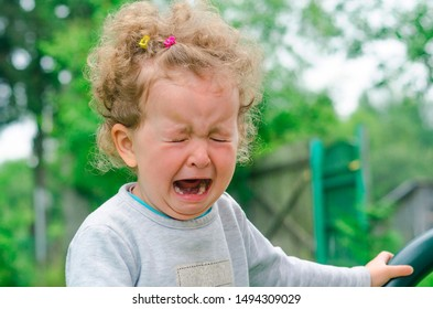 little girl crying. offend the child. children's tears and moods. comfort and feel sorry for the baby. hopelessness, despair, sobbing, resentment. fright.