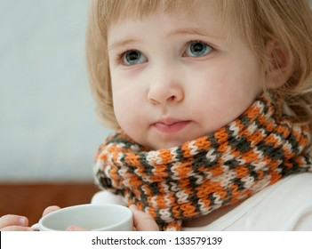 Little girl with a cup of tea