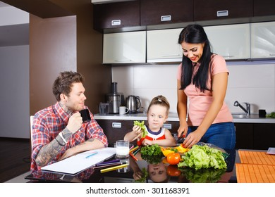 little girl cutting vegetables with her mother in the kitchen, stylish people, hipsters
