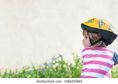 The Little girl with cycling helmet