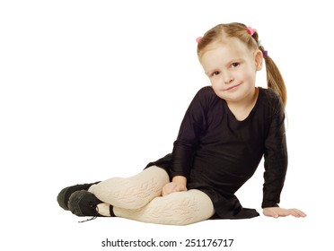 Little Girl dancer sits isolated on White Background