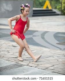 A little girl is dancing