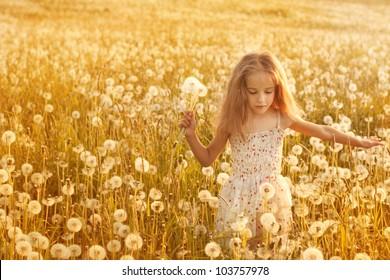 little girl with  dandelions