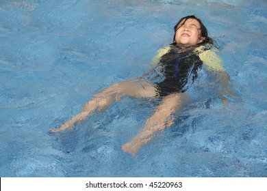 Little girl in danger drowning in the swimming pool