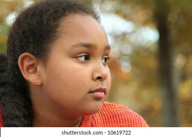 Little girl in deep thought