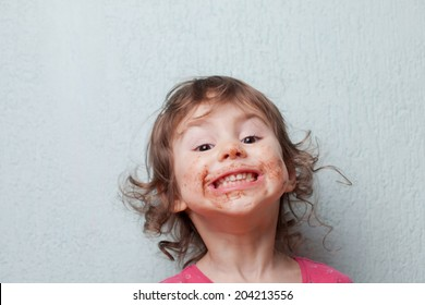 Little girl is dirty with chocolate. Funny face