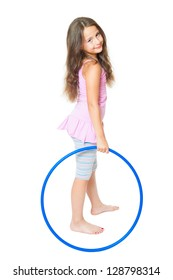 little girl doing fitness exercise with a blue hoop