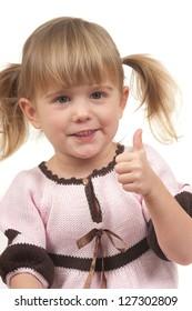 Little girl doing thumbs up