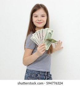 little girl with dollars