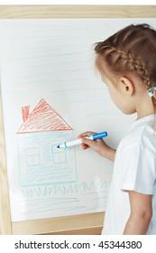 little girl draw on white desk