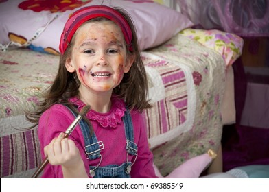 Little girl draw with water colors at home
