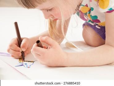 Little girl drawing  - closeup shot
