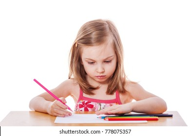 Little Girl drawing picture at table isolated on white