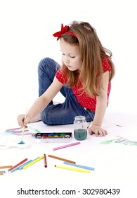 Little girl drawing with watercolors