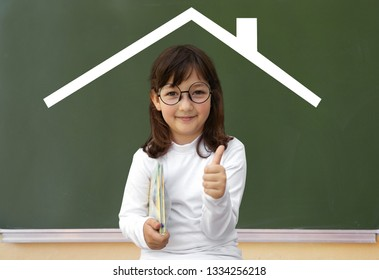 Little girl and drawn house on the school board