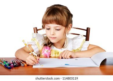 The little girl draws in an album felt-tip pens