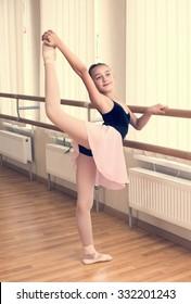 a little girl dressed as a ballerina in ballet