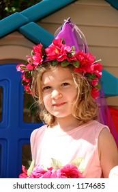 A little girl dressed up like a fairytale princess.