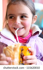 Little girl drinking soda
