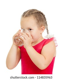 little girl drinking water from glass over white background