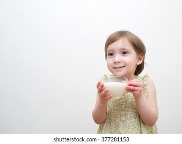 Little girl drinks milk