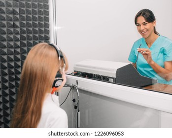 little girl during the hearing exam in the audiologist's office. audiogram, children ear exam