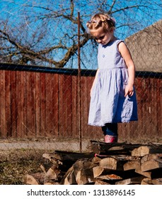 Little girl in early spring in the village