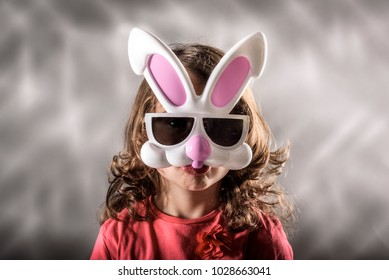 Little girl with the Easter bunny mask