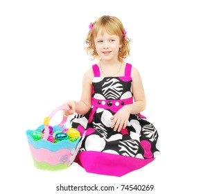 little girl with Easter eggs in a basket