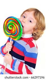 little girl eating big colorful lollipop
