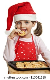 little girl eating Christmas cookies - white background