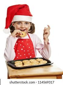 little girl eating Christmas cookies
