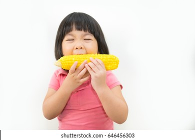 Little girl eating corn on white background.Hungry, Delicious, Eat Concept.