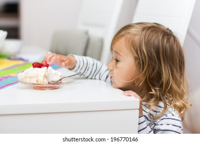 Little girl eating dessert with fruit.