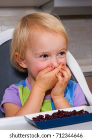 little girl eating dried berries