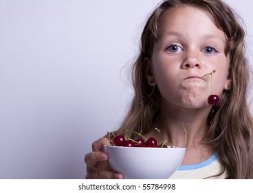 Little girl eating healthy food
