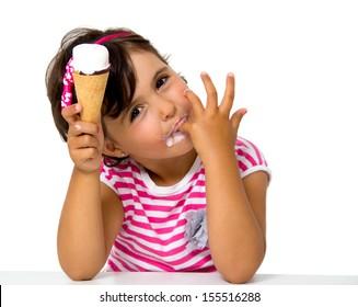 little girl eating ice cream isolated on white