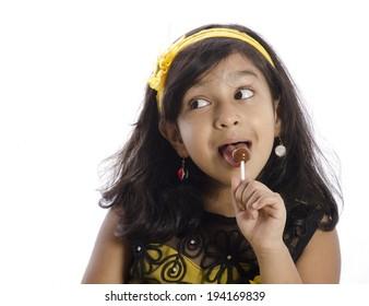 A little girl eating a lolypop