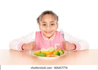 little girl eating vegetables isolated in white background